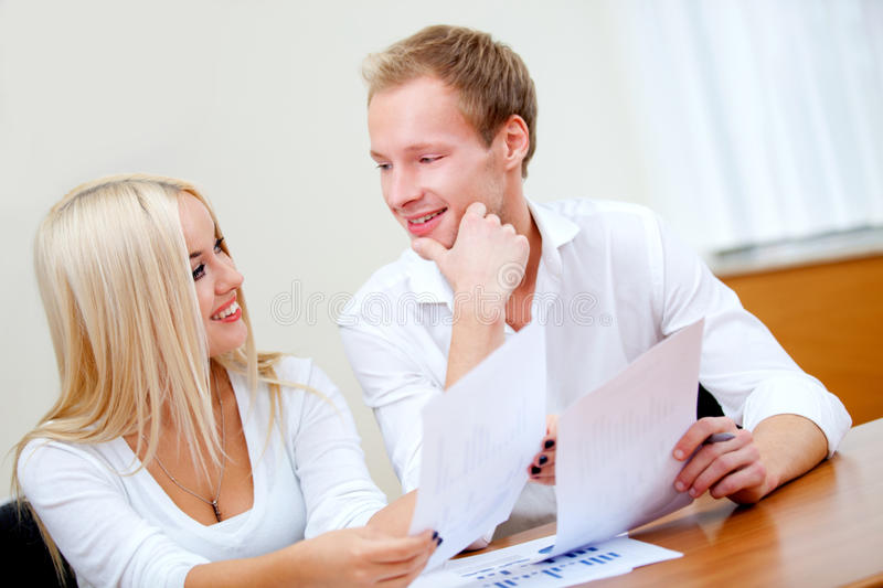 Download Business Couple On A Laptop Stock Photo - Image: 21650430