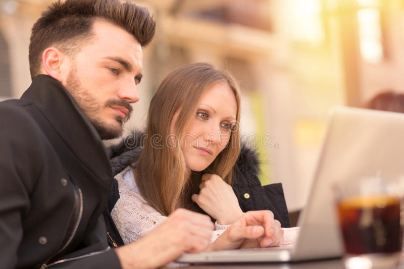 Business couple with a laptop stock image