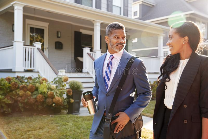Business Couple Leaving Suburban House For Commute To Work stock photos