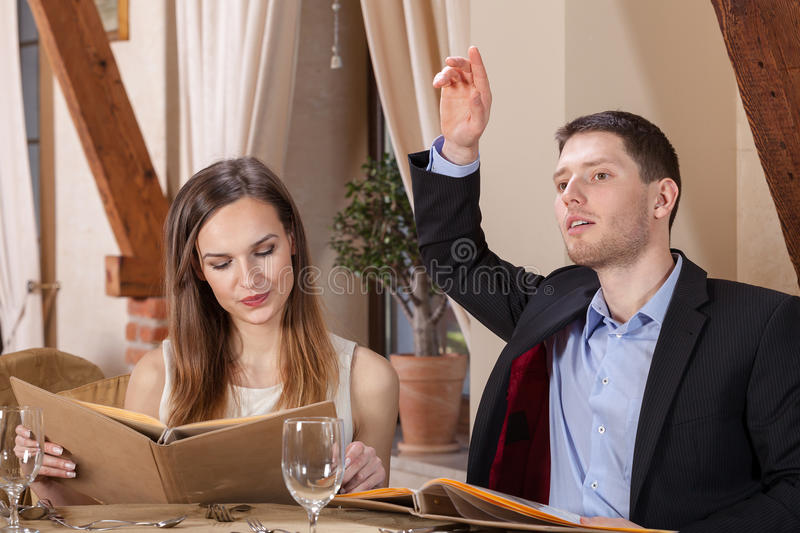 Business couple ordering dinner. In a restaurant stock images