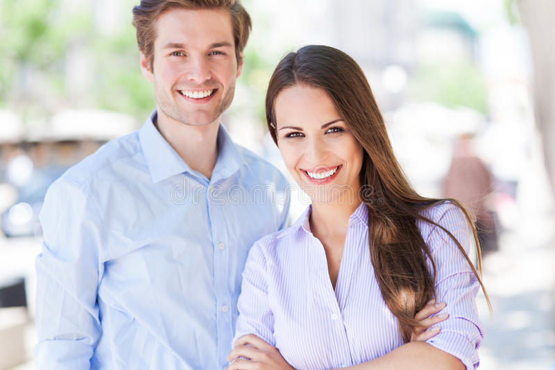 Business couple outdoors stock photo