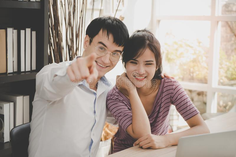 Business couple pointing at the camera royalty free stock photo
