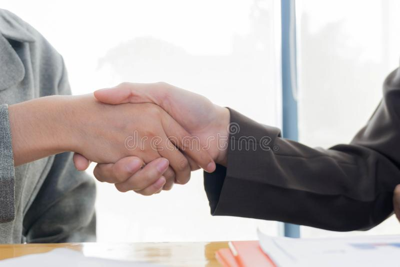 Hand of business couple shaking hands. royalty free stock images