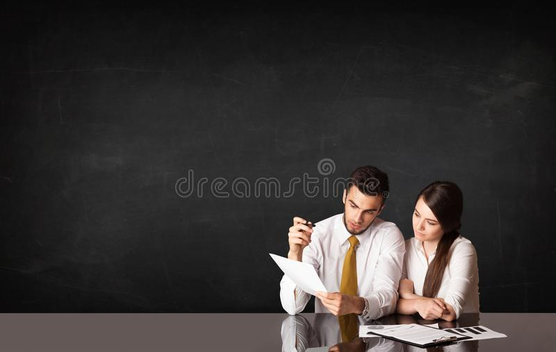 Business couple with black background stock photo