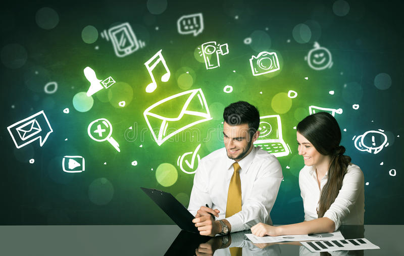 Business couple with social media symbols stock photos