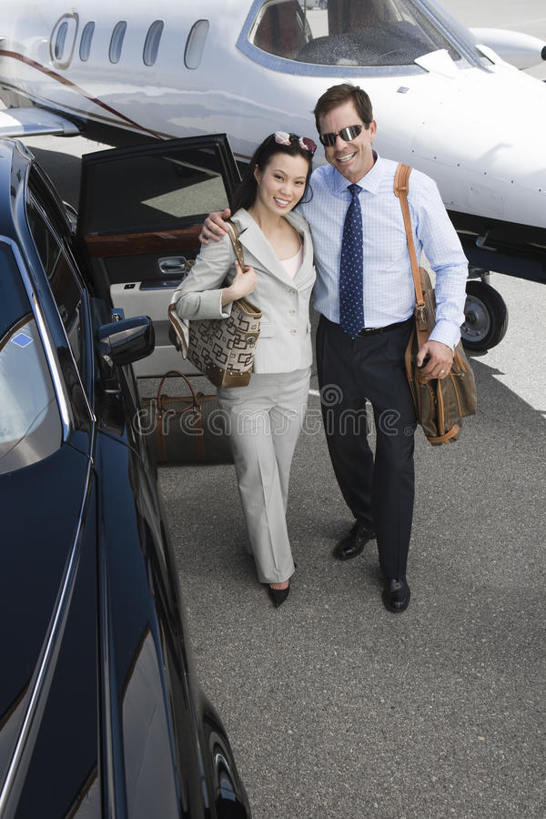 Download Business Couple Standing Together At Airfield Stock Image - Image: 29653011