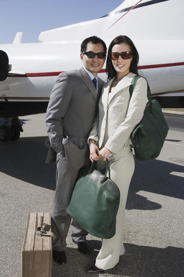 Download Business Couple Standing Together At Airfield Stock Image - Image: 29653027