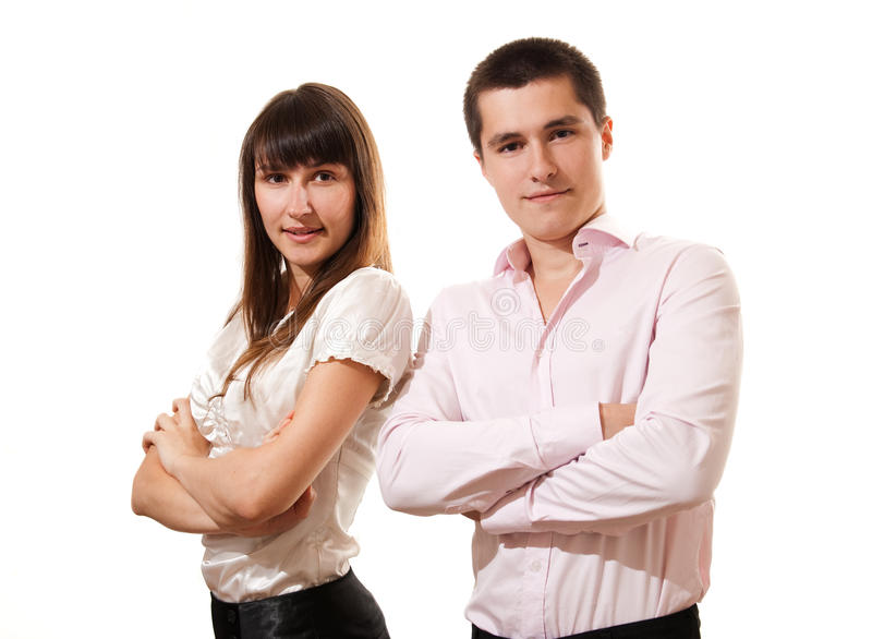 Business couple standing together with folded arms. Portrait of a cheerful business couple standing together with folded arms on white background stock images