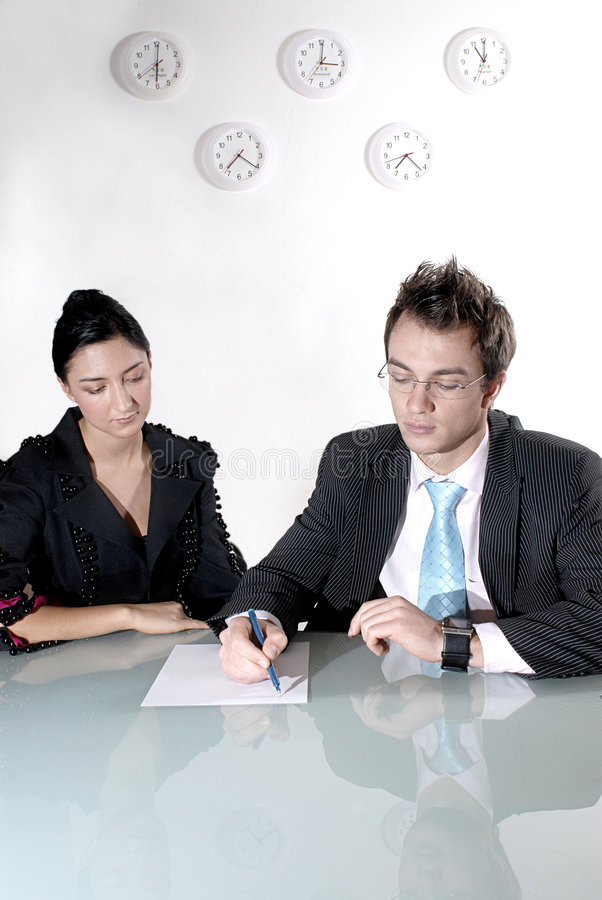 Business couple at table royalty free stock photo
