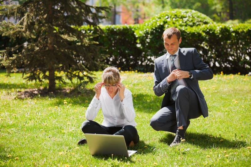 Business couple using laptop stock photos