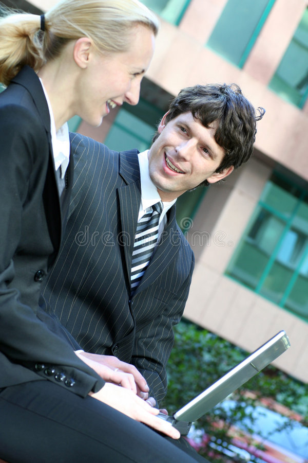 Download Business Couple Using Laptop Stock Photography - Image: 3287572