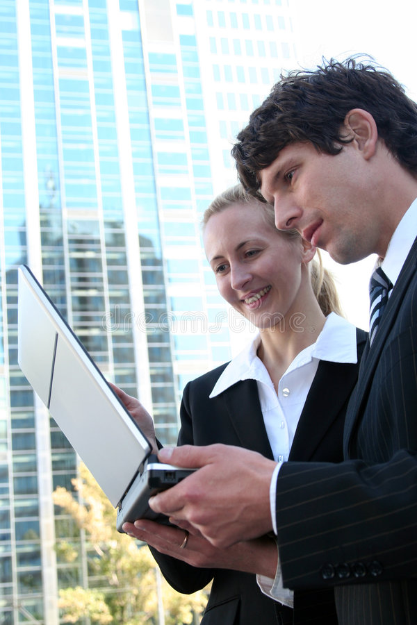 Download Business Couple Using Laptop Stock Photo - Image: 3288632