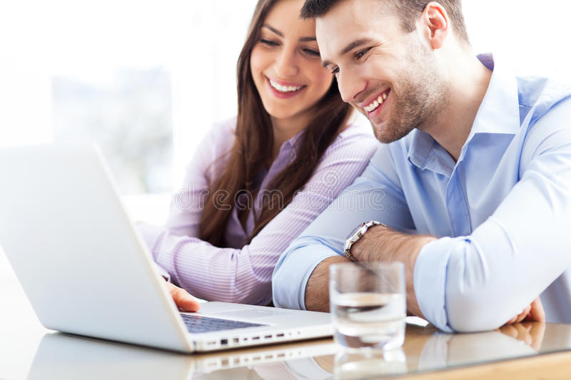 Business couple using laptop stock images