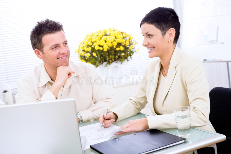 Business couple working. At office, smiling stock photography
