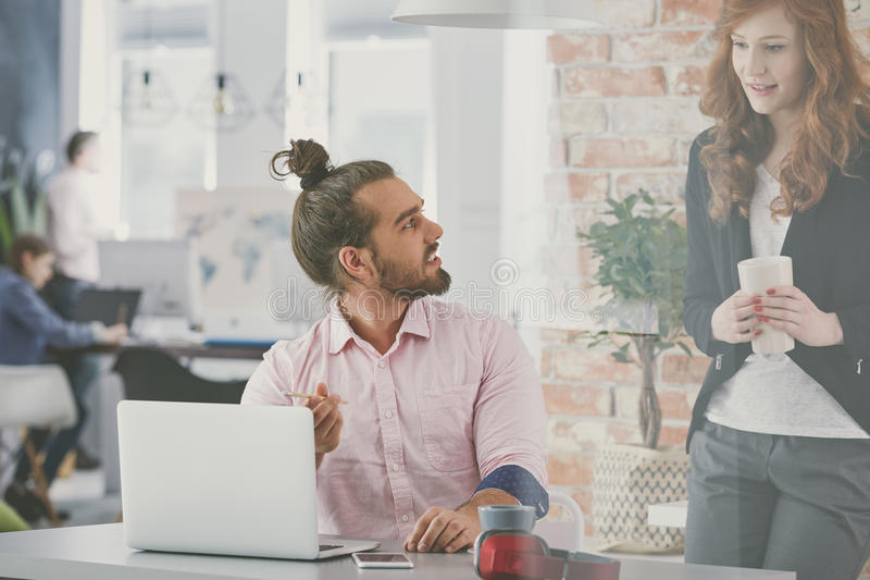 Business couple working in agency. Young and creative business couple working in agency stock image