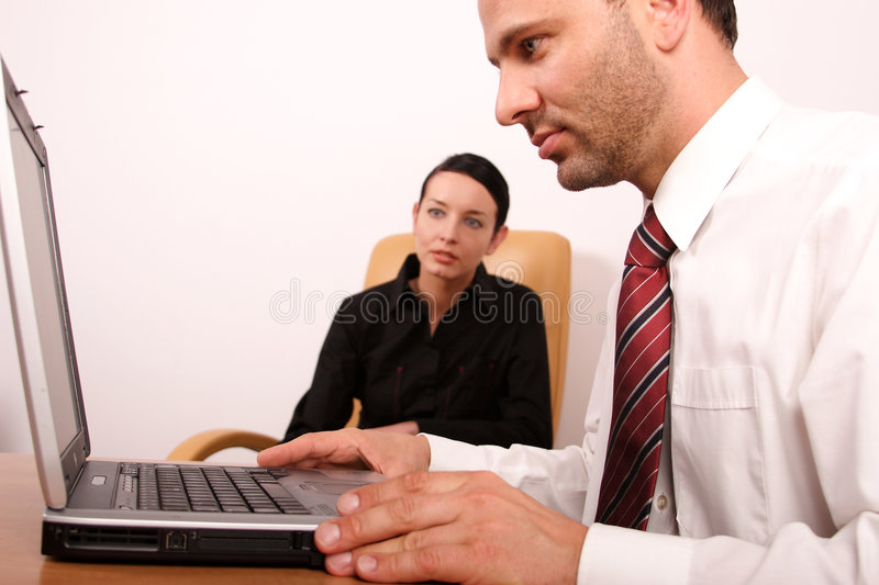 Business couple working in the office. Business couple working on the notebook royalty free stock images