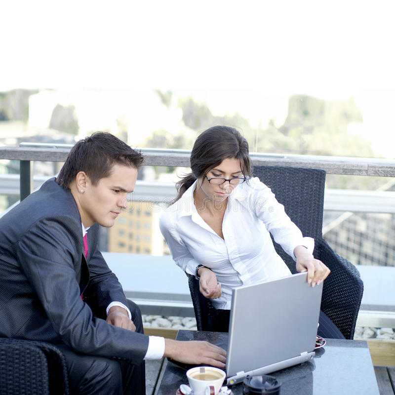 Business couple working outdoors stock images