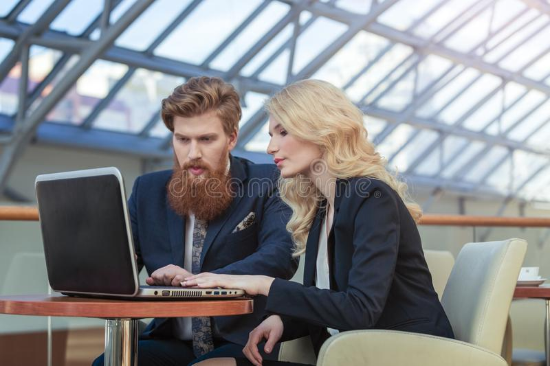 Business couple working together. On project at modern office stock photo