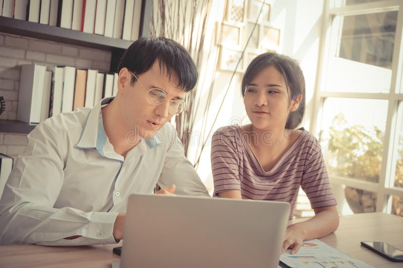 Business couple working together on laptop in cafe royalty free stock photo