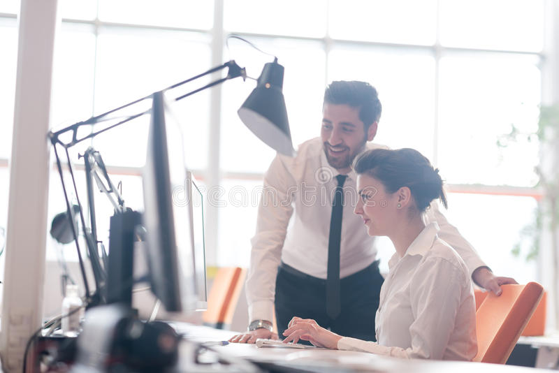 Business couple working together on project. At modern startup office royalty free stock photo
