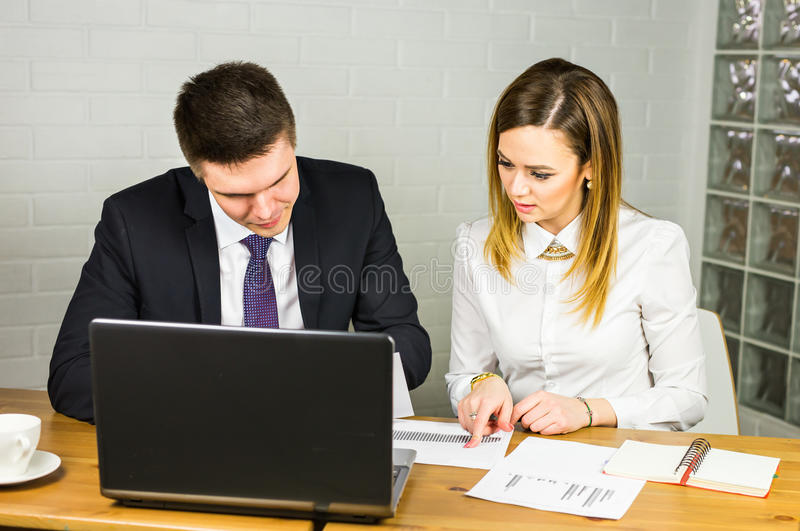 Business couple working together on project at modern startup office.  royalty free stock photos