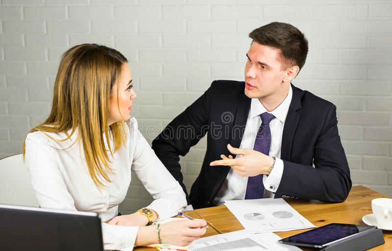 Business couple working together on project at modern startup office.  stock photo