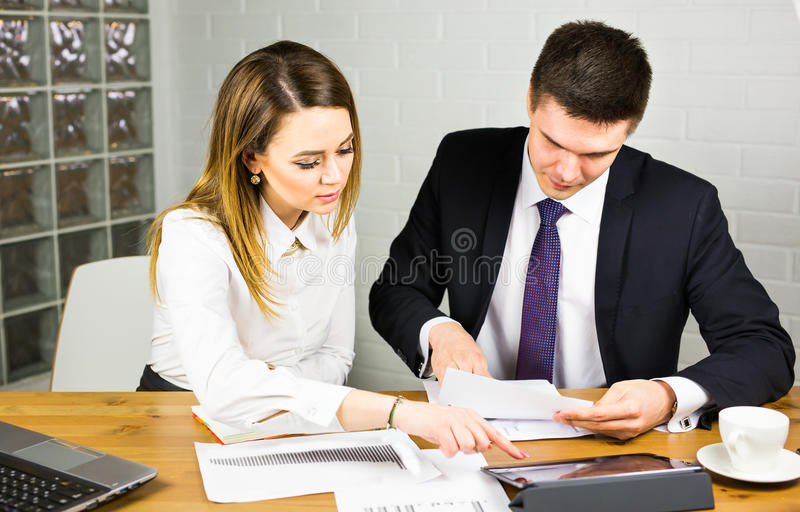 Business couple working together on project at modern startup office.  royalty free stock photography