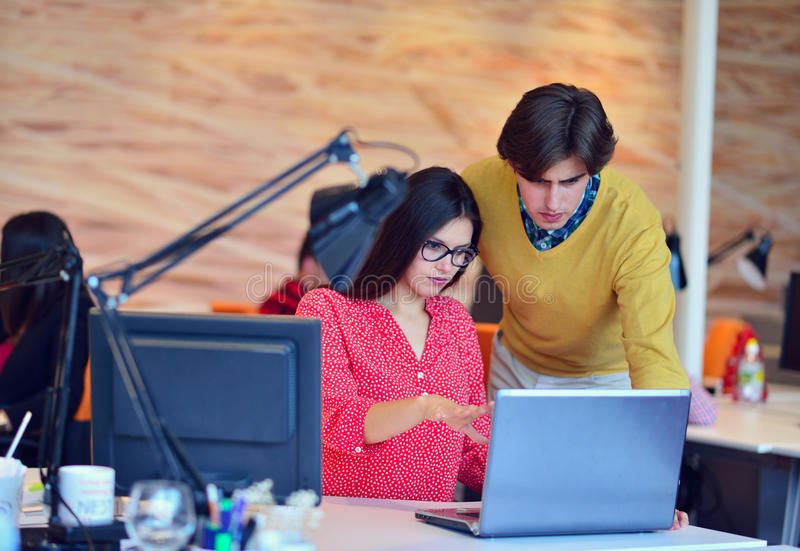 Business couple working together on project at modern startup office.  stock photography