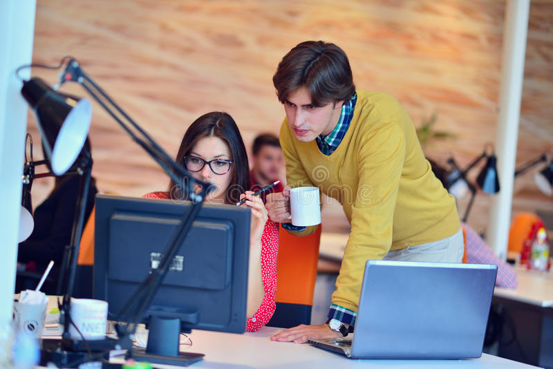 Business couple working together on project at modern startup office.  royalty free stock images