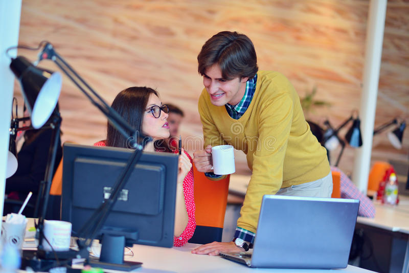 Business couple working together on project at modern startup office.  royalty free stock image