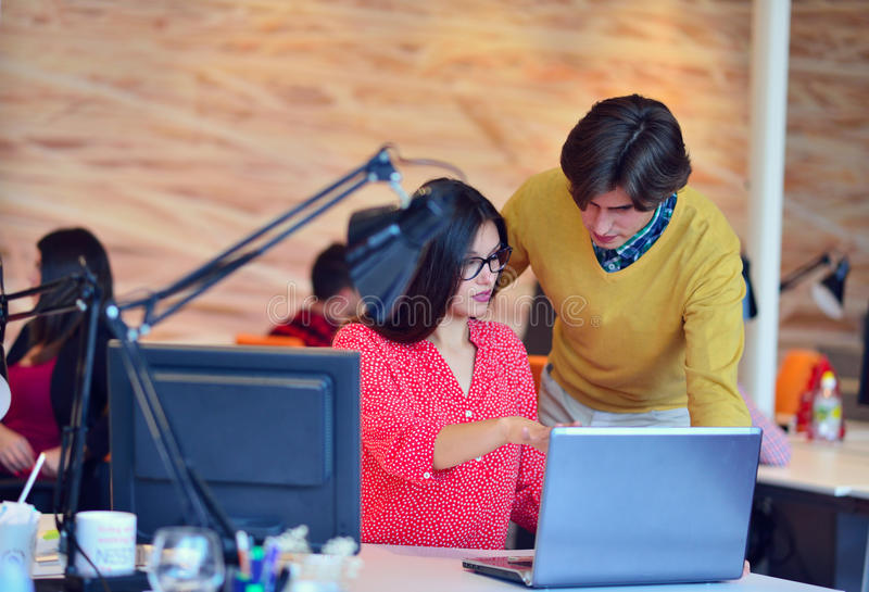Business couple working together on project at modern startup office. Couple working together on project at modern startup office royalty free stock photography