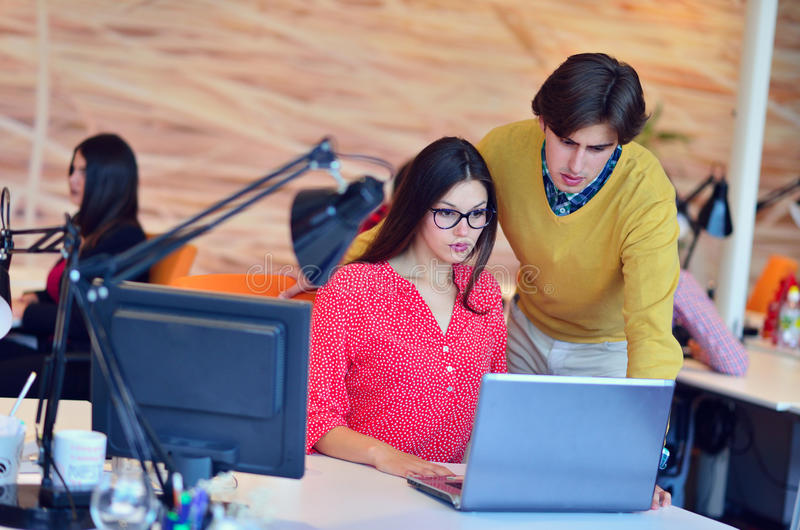 Business couple working together on project at modern startup office. Couple working together on project at modern startup office stock photo