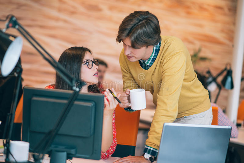 Business couple working together on project at modern startup office stock image
