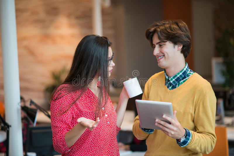 Business couple working together on project at modern startup office royalty free stock photo