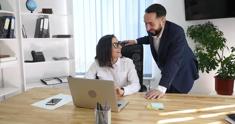 Business couple working together on project at modern startup office royalty free stock photos
