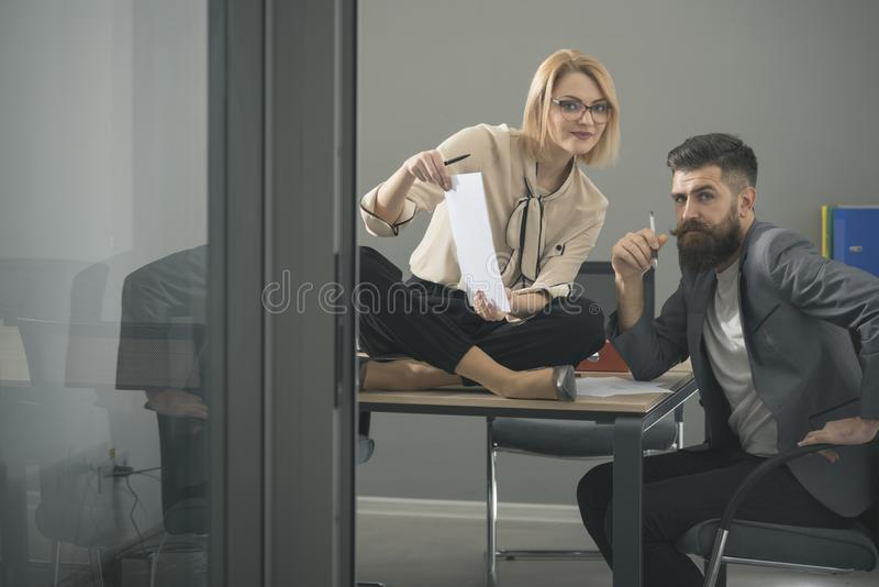 Business couple working together on project at modern startup office royalty free stock images