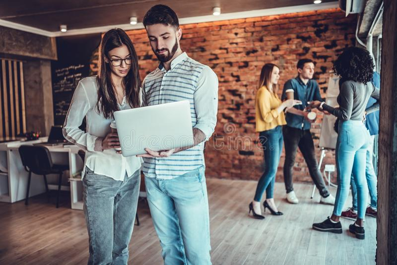 business couple working together on project at modern startup office stock images