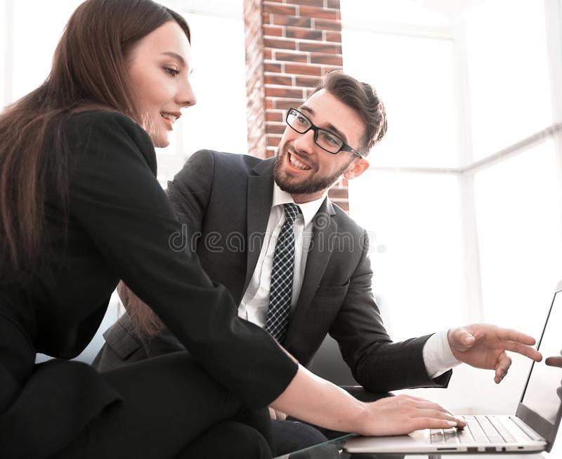 Couple of young designers working at modern office. Business couple working together on project at modern startup office stock image