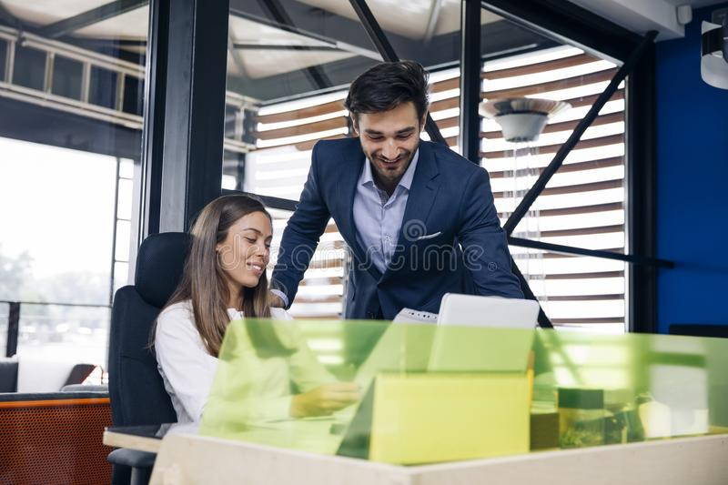 Business couple working together on project at modern startup of royalty free stock photos