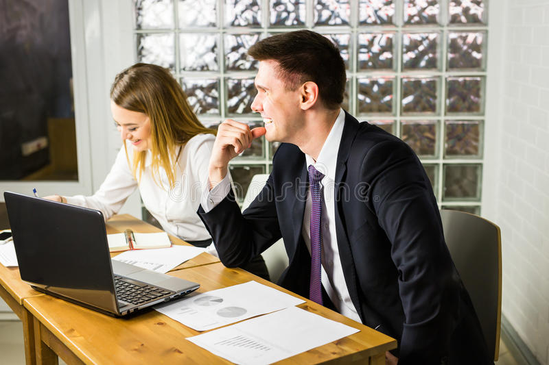 Business couple working together on project at office. Business couple working together on project at modern startup office stock photo