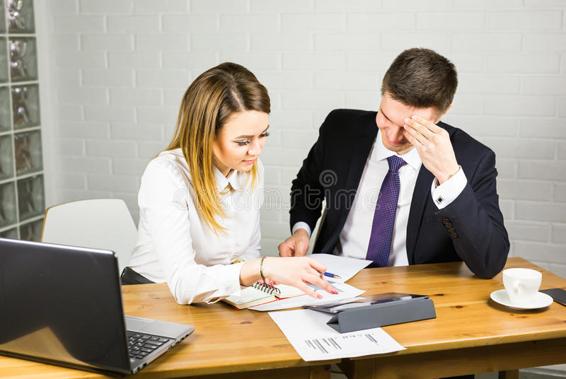 Business couple working together on project at office. Business couple working together on project at modern startup office royalty free stock photo