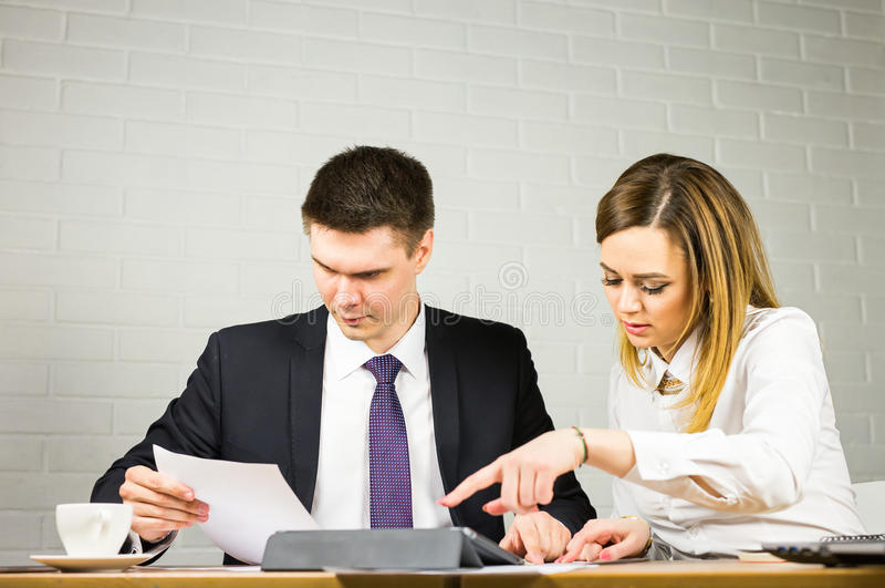 Business couple working together on project at office. Business couple working together on project at modern startup office stock image