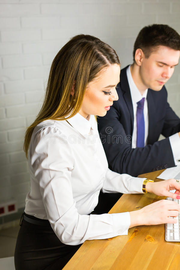 Business couple working together on project at office. Business couple working together on project at modern startup office royalty free stock photography
