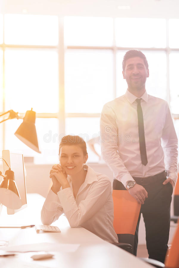business couple working together on project, sunrise in background stock photo