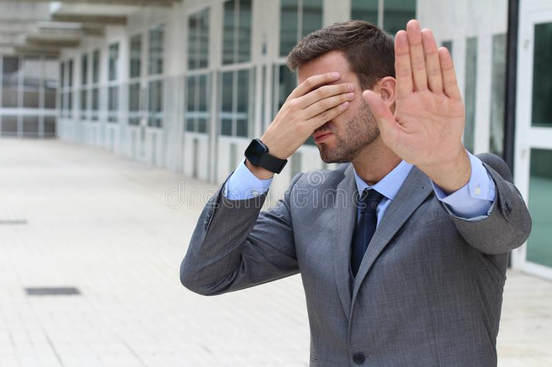 Business covering his eyes to avoid reality royalty free stock photos