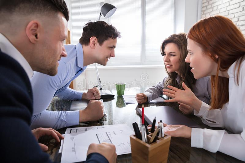Business Coworker Arguing To Each Other. At Workplace In Office royalty free stock image