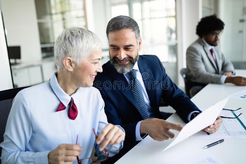 Business coworkers discussing new ideas and brainstorming in a modern office. Business coworkers discussing new ideas and brainstorming in office royalty free stock image