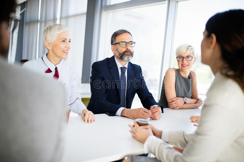 Business coworkers discussing new ideas and brainstorming in a modern office. Business coworkers discussing new ideas and brainstorming in office stock images