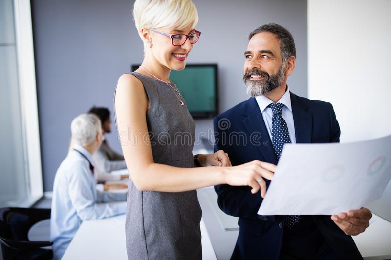 Business coworkers discussing new ideas and brainstorming in a modern office. Business coworkers discussing new ideas and brainstorming in office royalty free stock images