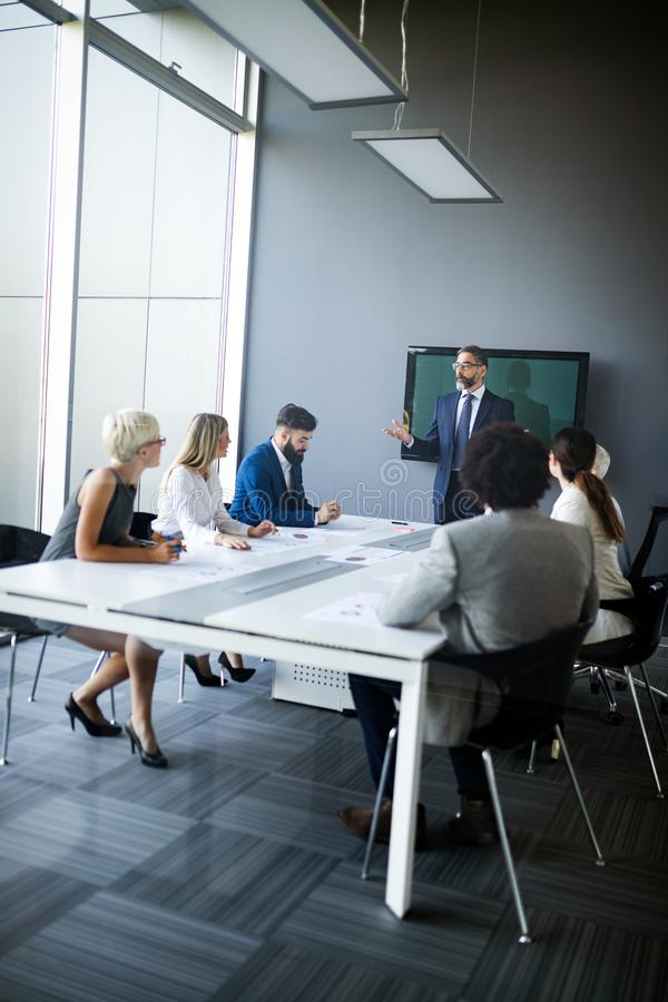 Business coworkers discussing new ideas and brainstorming in a modern office royalty free stock images